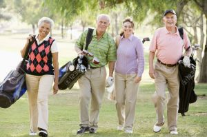 4507136-Portrait-Of-Four-Friends-Enjoying-A-Game-Golf-Stock-Photo-senior